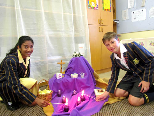 Learners at Linmeyer Marist College in Johannesburg light candles in their classroom during Lent this year.