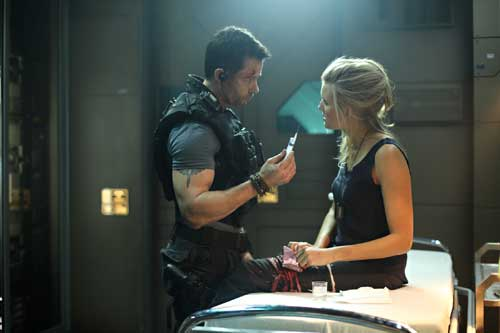 """Guy Pearce and Maggie Grace star in a scene from the movie """"Lockout."""""""