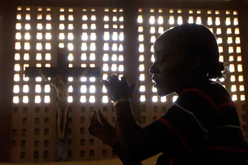 A Catholic woman sings during Mass at a church in Garissa, Kenya. (Photo: Goran Toma sevic, Reuters/CNS)