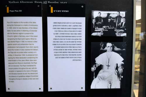 A photograph of Pope Pius XII is seen next to a controversial caption about his actions during the Holocaust, in an exhibit at theYad Vashem Holocaust History Museum in Jerusalem (Photo: Debbie Hill/CNS)