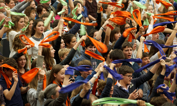 Young people wave bandanas as they attend Pope Benedict XVI's general audience in Paul VI hall at the Vatican Nov. 14. (CNS photo/Paul Haring)