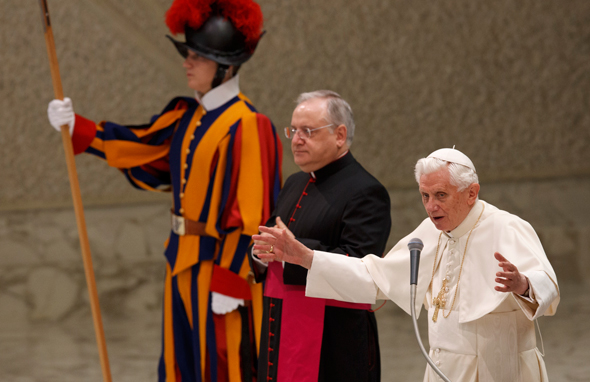 Pope Benedict leads a prayer as he begins his general audience in Paul VI hall at the Vatican. (CNS photo/Paul Haring)