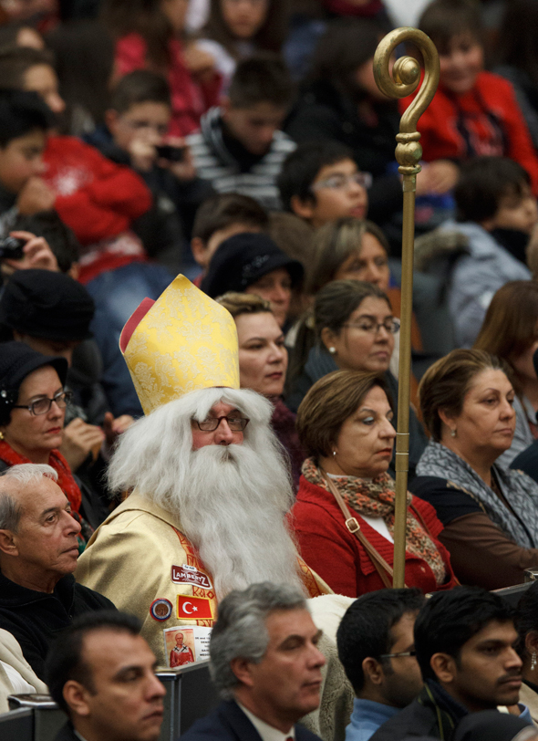 A man dressed as St. Nicholas attends Pope Benedict XVI's general audience in Paul VI hall at the Vatican. (CNS photo/Paul Haring)