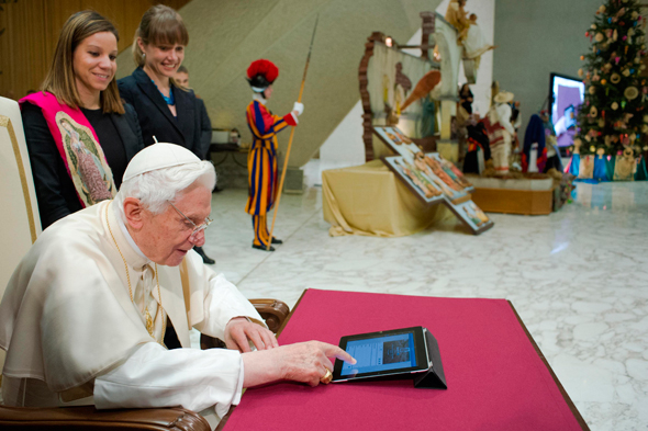 Pope Benedict XVI posts his first tweet on his Twitter account @Pontifex in Paul VI hall at the Vatican. (CNS photo/L 'Osservatore Romano via Reuters)
