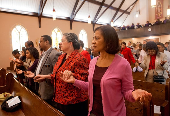 """""""The parish congregation contains a network of relationships—close, loose and anonymous—that form its human texture."""" (CNS photo/Nancy Phelan Wiechec)"""