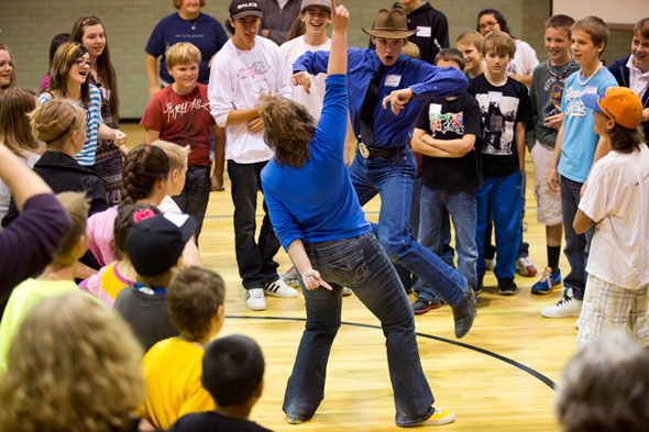 """Kellen Garegon and Jordan Ruter go head-to-head in a tie breaker during a game called """"Bessey the Heffer"""" at a Year of Faith youth rally at St. Patrick's Church in Casper, Wyo., Oct. 13. The special year, declared by Pope Benedict XVI, is a worldwide pro gram of worship, catechesis and evangelisation. It opened Oct. 11 and runs to Nov. 24, 2013. (CNS photo/Tim Kupsick)"""
