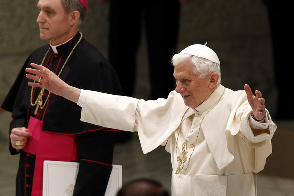 Pope Benedict XVI greets the crowd as he begins his general audience in Paul VI hall at the Vatican on February 13, two days after announcing that he no longer has strength to exercise his ministry and will retire at the end of the month. (CNS photo/Paul Haring)