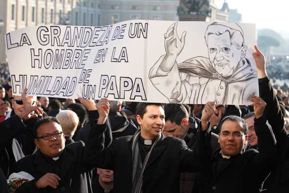 "Mexican seminarians who study in Rome hold a sign in Spanish saying, ""The greatness of a man in the humility of a pope,"" as they wait for the start of Pope Benedict XVI's final general audience in St. Peter's Square at the Vatican. (CNS photo/Paul Haring)"