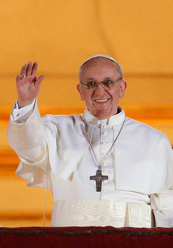 Pope Francis I appears for the first time on the central balcony of St. Peter's Basilica at the Vatican March 13. Cardinal Jorge Mario Bergoglio of Argentina was elected the 266th Roman Catholic pontiff. He is the first Jesuit and first Latin American pope. (CNS photo/Paul Haring)