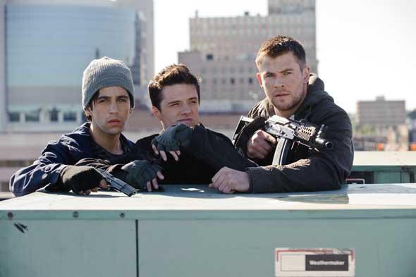 "Josh Peck, Josh Hutcherson and Chris Hemsworth star in a scene from the movie ""Red Dawn."" (CNS photo/FilmDistrict)"
