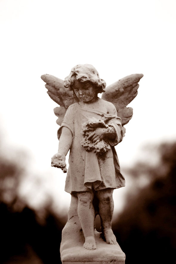 A figure of a child angel on a gravestone. In 2007, the Vatican's International Theological Commission said there are good reasons to hope that babies who die without baptism go to heaven. (Photo: Bob Roller, CNS)