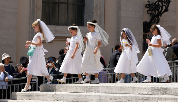 Girls in first Communion dresses attend Pope Francis' general audience in St. Peter's Square at the Vatican April 24. (CNS photo/Paul Haring)