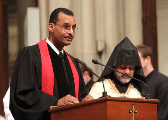 A pastor leads an ecumenical prayer service at St Patrick's cathedral in New York