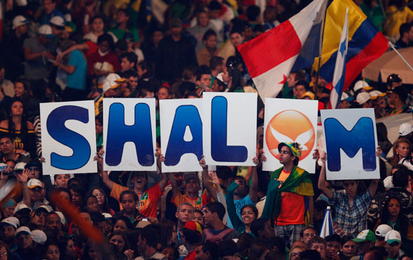 "Young people hold up letters spelling out ""shalom,"" the Hebrew greeting meaning peace, during the World Youth Day vigil on Copacabana beach in Rio de Janeiro July 27. (CNS photo/Paul Haring)"