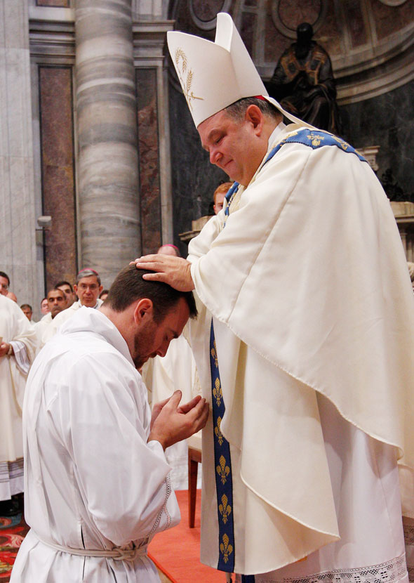 """""""...crucial because it establishes a very real and sacramental bond between the new deacon or priest and the bishop into whose ministry he is ordained""""  (CNS photo/Paul Haring)"""