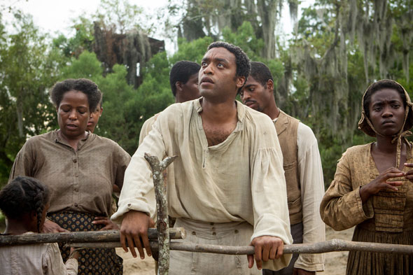 "Chiwetel Ejiofor, center, stars in a scene from the movie ""12 Years a Slave.""  (CNS photo/Fox Searchlight)"