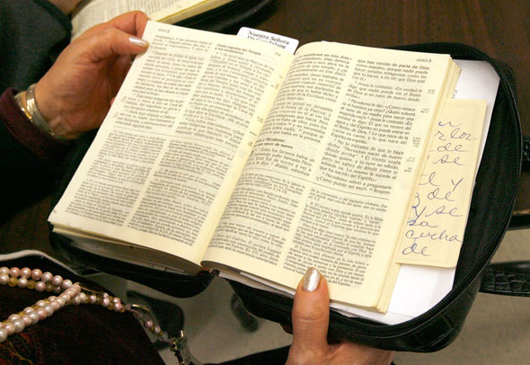 A woman studies the Bible in 2009 at St. Mary of Celle Parish in Berwyn, Ill. God constantly tries to enter into dialogue with the people he created, particularly through the Bible and through his son Jesus Christ, Pope Benedict XVI said. (CNS photo/Karen Callaway, Catholic New World)