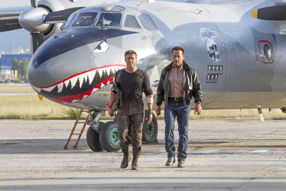 "Sylvester Stallone and Arnold Schwarzenegger star in a scene from the movie ""The Expendables 3. (CNS photo/Lionsgate)."