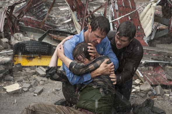 "Max Deacon, Richard Armitage and Nathan Kress star in a scene from the movie ""Into the Storm."" (CNS photo/Warner Bros.)"