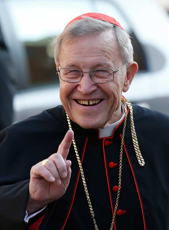 German Cardinal Walter Kasper, retired president of the Pontifical Council for Promoting Christian Unity, gestures as he arrives for the opening session of the extraordinary Synod of Bishops on the family at the Vatican Oct. 6. (CNS photoPaul Haring)
