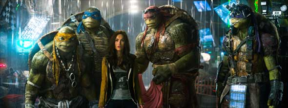"Animated characters Michelangelo, Leonardo, Raphael, Donatello and actress Megan Fox as April, center, appear in the movie ""Teenage Mutant Ninja Turtles."" (CNS photo/Paramount)"