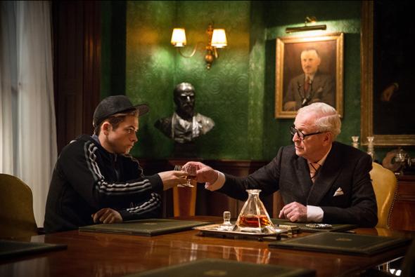 "Taron Egerton and Michael Caine star in a scene from the movie ""Kingsman: The Secret Service."" (CNS photo/20th Century Fox Film Corporation via EPK TV)"