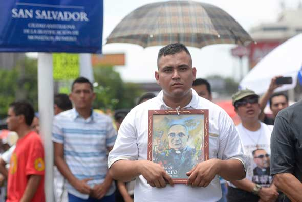 Pilgrim holds a portrait of Archbishop Oscar Romero during beatification Mass May 23 in the Divine Savior of the World square in San Salvador. (CNS photo/Lissette Lemus)