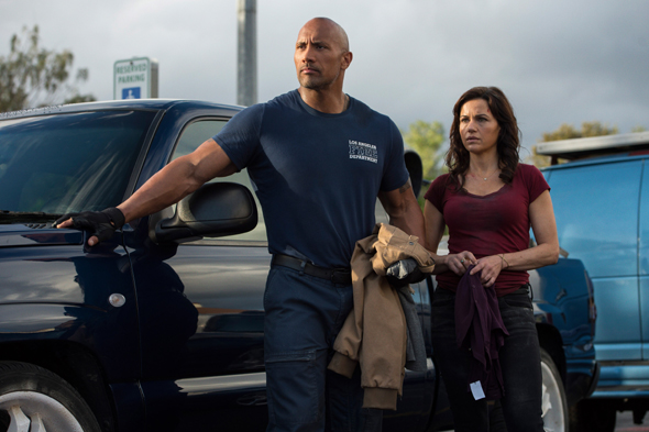 "Dwayne Johnson and Carla Gugino star in a scene from the movie ""San Andreas."" (CNS photo/Warner Brothers)"