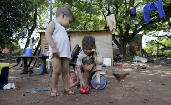 """""""Selling and trafficking of children, debt bondage and serfdom, forced recruitment of children for armed conflict, child prostitution, pornography, and drug activities are among the worst forms of labour millions of children are trapped in."""" (CNS photo/Jorge Adorno, Reuters)"""