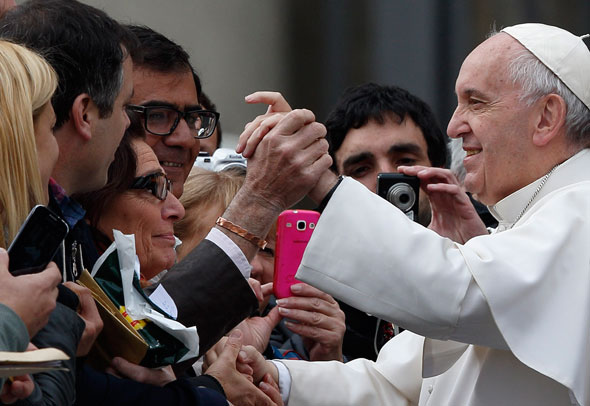 Pope Francis greets people during his general audience in St. Peter's Square at the Vatican Oct. 21. (CNS photo/Paul Haring)
