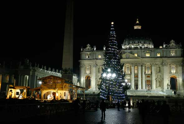 The Christmas tree and Nativity scene decorate St. Peter's Square after a lighting ceremony at the Vatican. (CNS photo/Paul Haring)