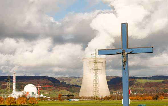 A crucifix is pictured in front of a cooling tower of a nuclear power plant near the northern Swiss town of Leibstadt Nov. 18. (CNS photo/Arnd Wiegmann, Reuters)