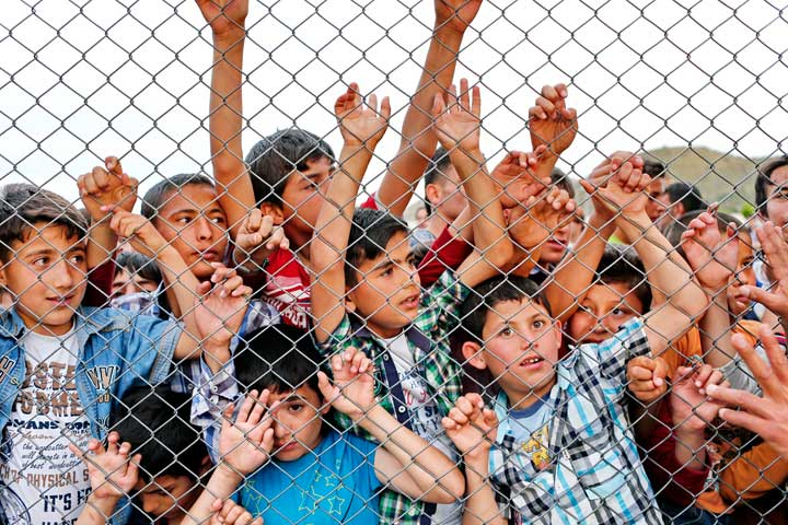 Syrian children stand at a fence at a refugee camp near Gaziantep, Turkey. Catholics should protest against immigration policies that put the lives of children at risk, said Cardinal Vincent Nichols of Westminster, England. (Photo: Sedat Suna, EPA/CNS)