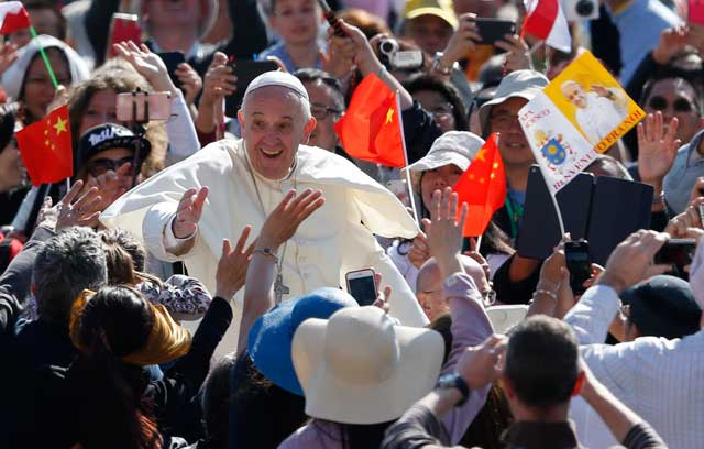 Pope Francis greets the crowd during his general audience in St. Peter's Square at the Vatican May 4. (CNS photo/Paul Haring)