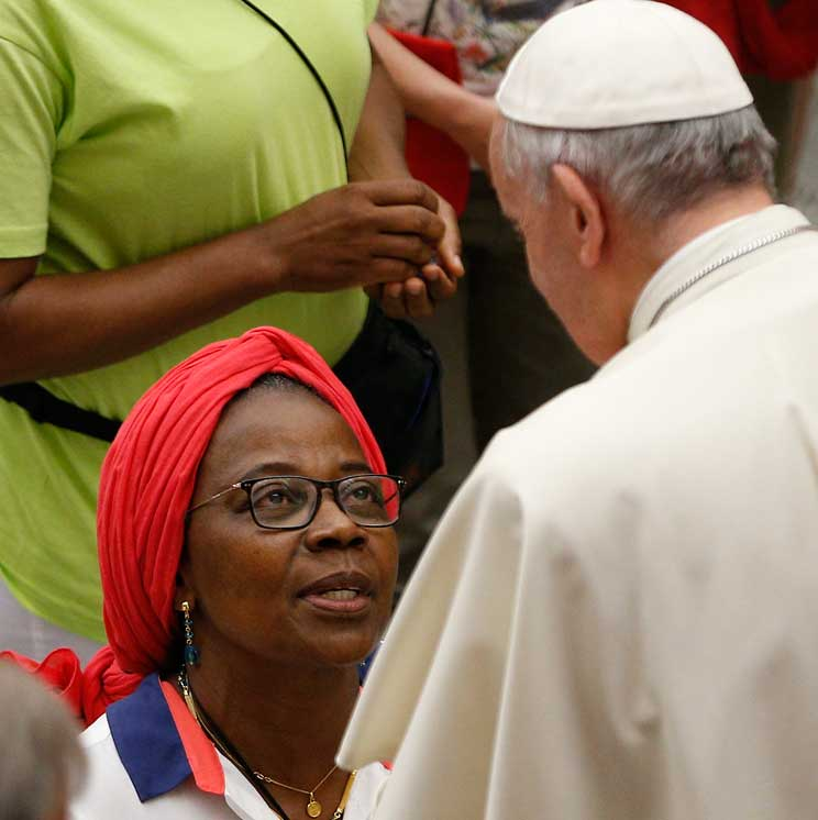 Pope Francis greets a woman during an audience with people from Lyon, France, in Paul VI hall at the Vatican July 6. The audience was with 200 people living in difficult or precarious situations. (CNS photo/Paul Haring)